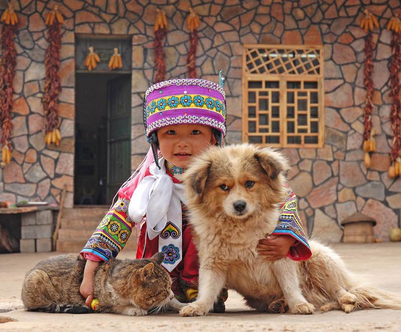 Child with dog and cat.